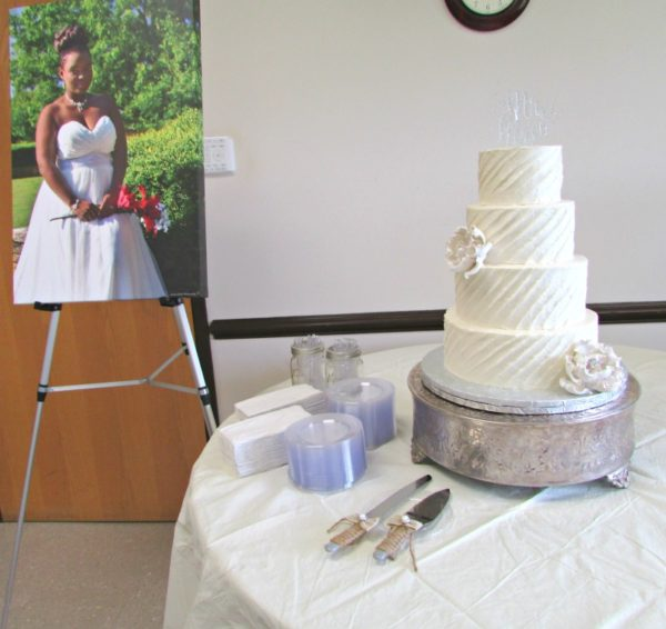 Rustic wedding cake table with bridal portrait